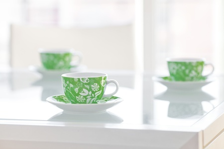 three cups of tea on a glass table Stock Photo - 13710453