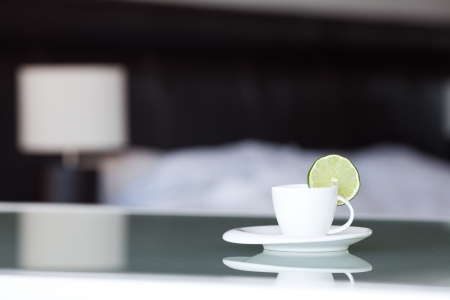 tea with lemon on the background of the bed and the lamp Stock Photo - 13710523