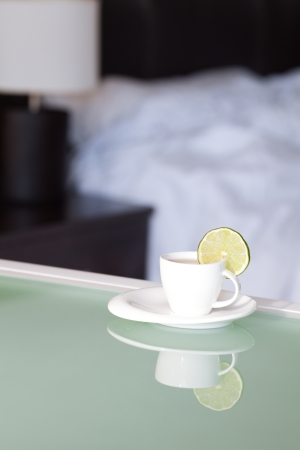 tea with lemon on the background of the bed and the lamp photo