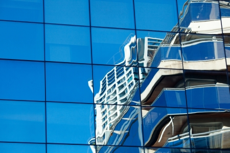 background of the glass modern office building photo