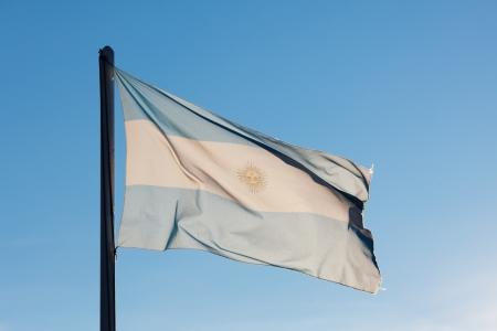 argentina flag: Flag of Argentina against the blue sky Stock Photo