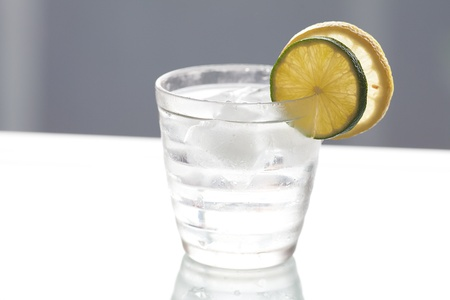 water with lemon and lime in a glass with ice photo