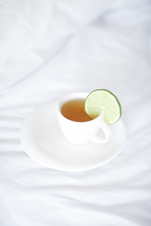 bed with a pillow and a cup of tea Stock Photo - 13789800