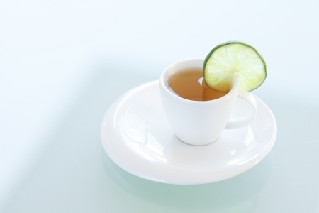 free plates: cup of tea with lime on a glass surface Stock Photo