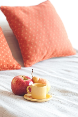 cup of tea,apple and pear on the bed Stock Photo - 13799483
