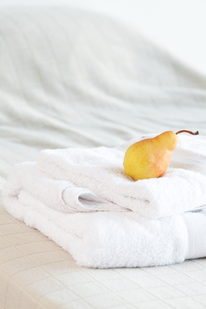 pear lying on towels on the bed  photo