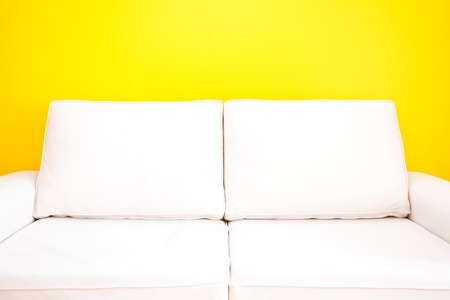 white sofa against a yellow wall in the apartment Stock Photo - 13821244