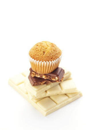 bar of chocolate and muffin isolated on white photo