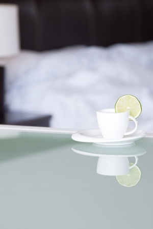 tea with lemon on the background of the bed and the lamp Stock Photo - 13965566