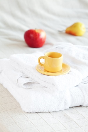 cup of tea,apple and pear on the bed photo
