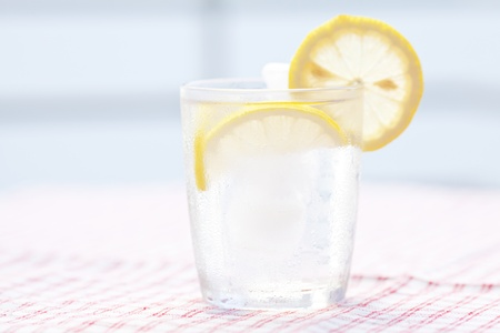 ice water: water with lemon and lime in a glass with ice