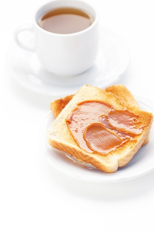 tea and toast with caramel isolated on white photo