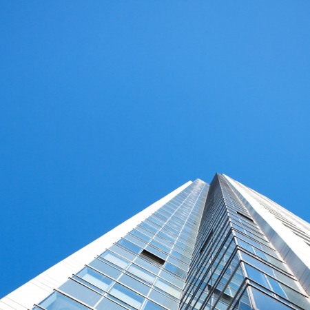 Beautiful modern office building against the blue sky photo