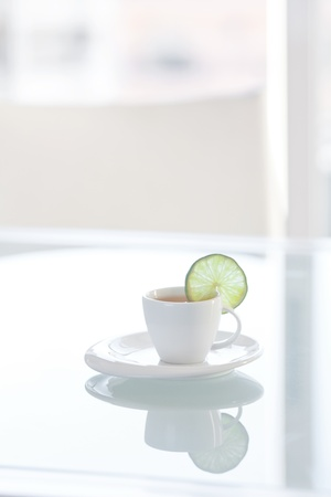 cup of tea with lemon on a glass surface Stock Photo - 14074223
