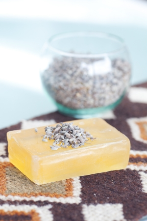 lavender in bowl and soap on ethnic mat photo