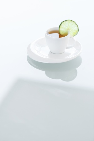cup of tea on a glass surface photo