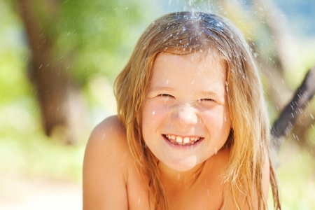 beach blond hair: portrait of a beautiful little girl outdoor