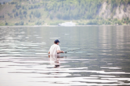 young man fishing in the river