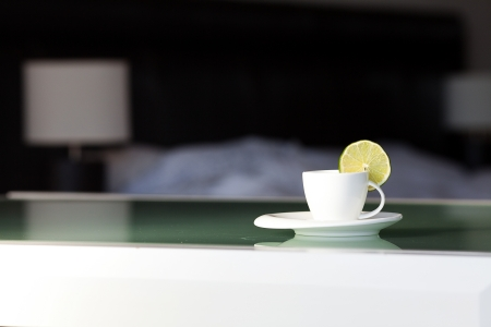 tea with lemon on the background of the bed and the lamp Stock Photo - 15172910