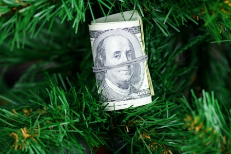 stack of dollars on the Christmas tree photo