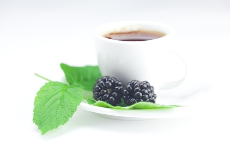 cup of tea and  blackberry with leaves photo