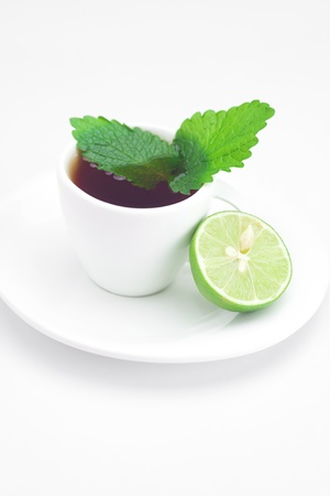 cup of tea,mint and lime isolated on white photo