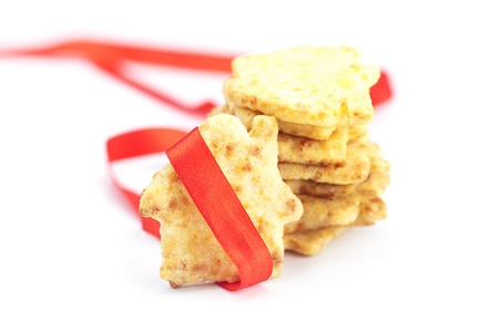 Cookies in the form of a house with red ribbon isolated on white Stock Photo - 18306800