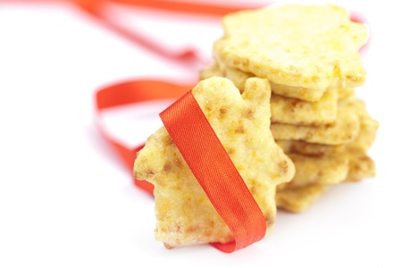 Cookies in the form of a house with red ribbon isolated on white Stock Photo - 18306832