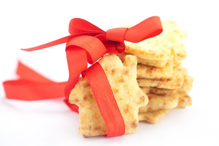 Cookies in the form of a house with red ribbon isolated on white Stock Photo - 18306823