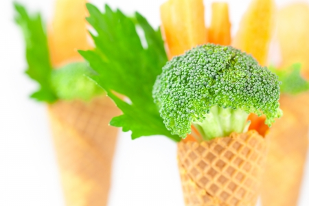 carrot, celery, broccoli in a waffle cone isolated on white photo