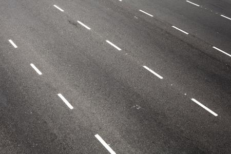 dividing: road with dividing white stripes