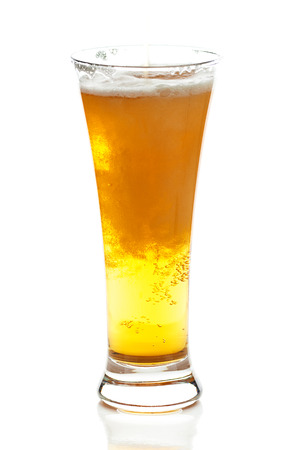 beerglass: light beer with the foam in a tall glass isolated on white