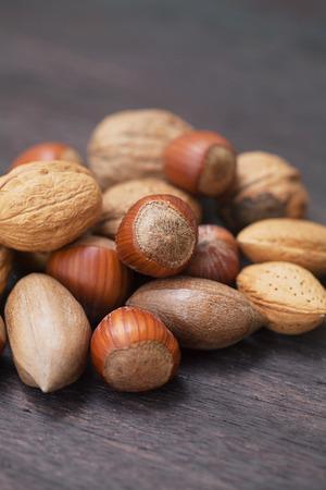 heap of nuts on a wooden surface Standard-Bild