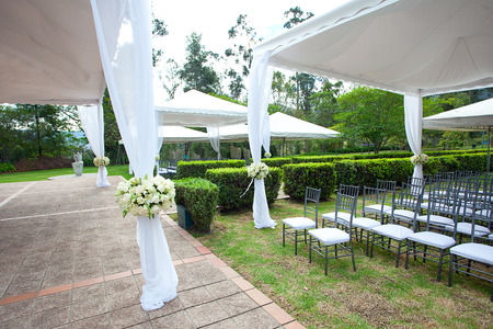 wedding marquee with bouquets of roses photo