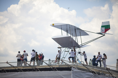 VARNA - JULY 2: A competitor is jumping an improvised aircraft in the sea during the Red Bull Flugtag on July 2 , 2016 in Varna, Bulgaria