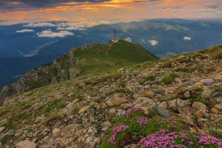 Caraiman Heroes Cross Monument and beautiful sunrise in Bucegi mountains,Carpathians,Romania
