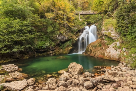 ravine: Sum waterfall and wooden bridge in the Vintgar Canyon in Slovenia,Europe Stock Photo