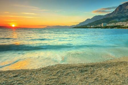Sunset over the beach,Makarska,Dalmatia,Croatia photo