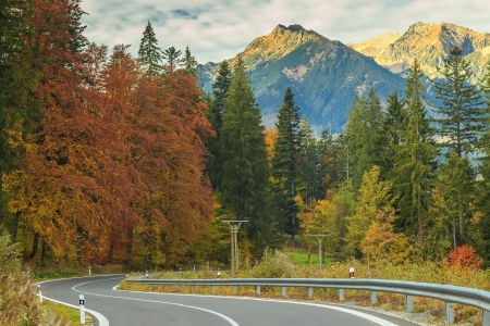 sunny cold days: Curve asphalt road and Tatry mountains on Slovakia-Poland border