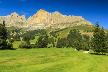 Golf course,cable car and beautiful landscape in Dolomites,South Tyrol,Italy photo