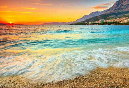 Magical sunset over the beach,Makarska,Dalmatia,Croatia photo