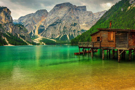 Hut on Braies Lake in Dolomiti mountains and Seekofel in background,Sudtirol,Italy Editorial