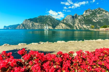 High mountains and sailing boat on the Lake Garda,Italy,Europe Standard-Bild