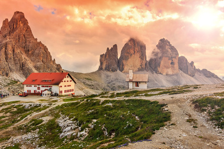 refuge: Beautiful sunset and high towers in Italy Alps,Tre Cime Di Lavaredo,Dolomites,Europe Stock Photo