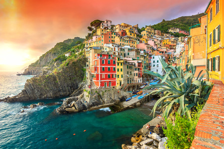 vernazza: Panorama of Riomaggiore and wonderful sunset,Cinque Terre National Park,Liguria,Italy,Europe Stock Photo