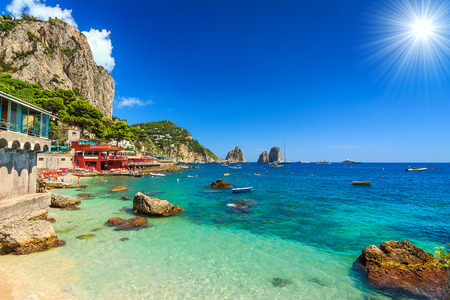 Faraglioni cliffs and wonderful beach in Capri island,Italy,Europe Imagens