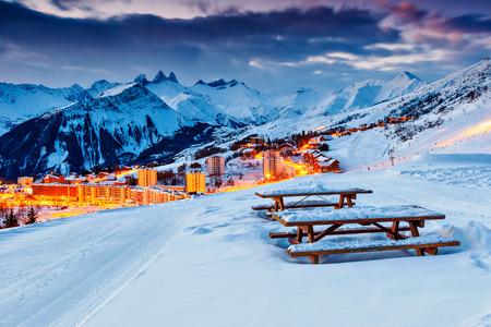 ski slopes: Majestic winter sunrise landscape and ski resort in French Alps,La Toussuire,France,Europe