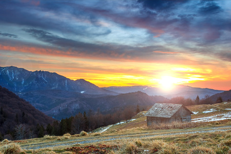 refuge: Majestic sunrise in the mountains and wooden hut,Ciucas mountains,Carpathians,Transylvania,Romania,Europe