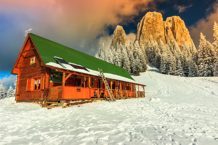 refuge: Winter landscape and wooden hut in the mountains,Lonely Rock, Transylvania, Carpathians, Romania, Europe Editorial