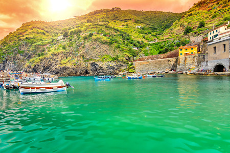 cinque terre: Amazing sunset and fishing harbor with boats,Vernazza village,Cinque Terre,Italy,Europe Editorial